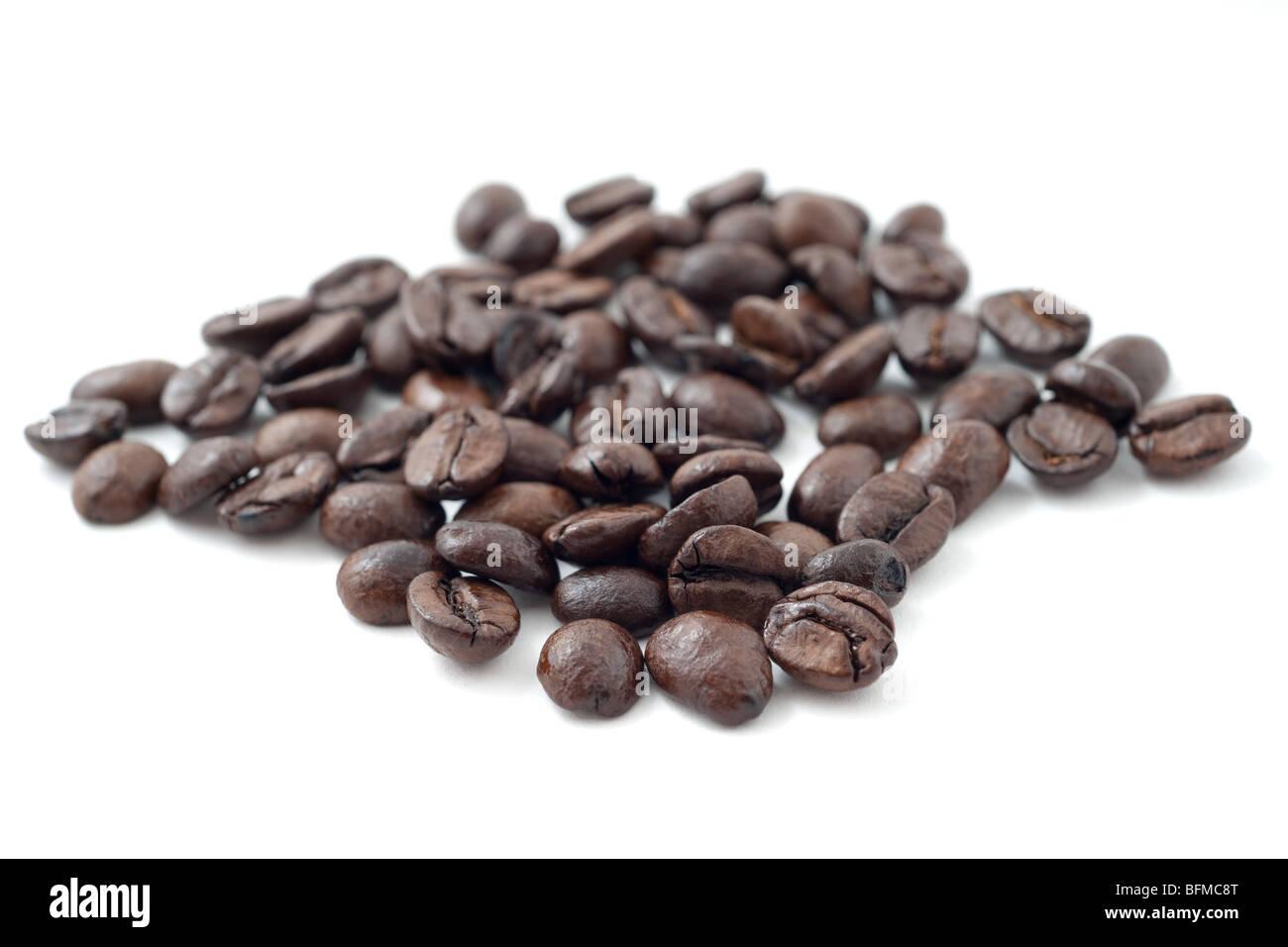 Macro studio shot of roasted African Java coffee beans in a pile ...