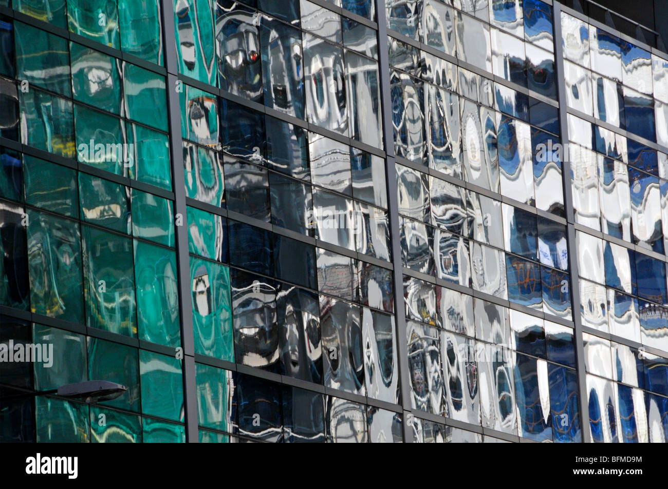 a49beddfe32 Mirror glass on buildings showing distorted abstract reflections - Stock  Image