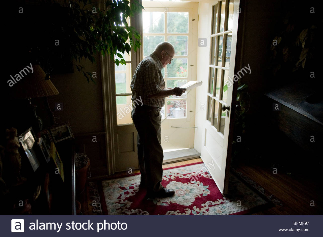 An 80 Year Old Man Uses Natural Light To Read His Birthday Cards