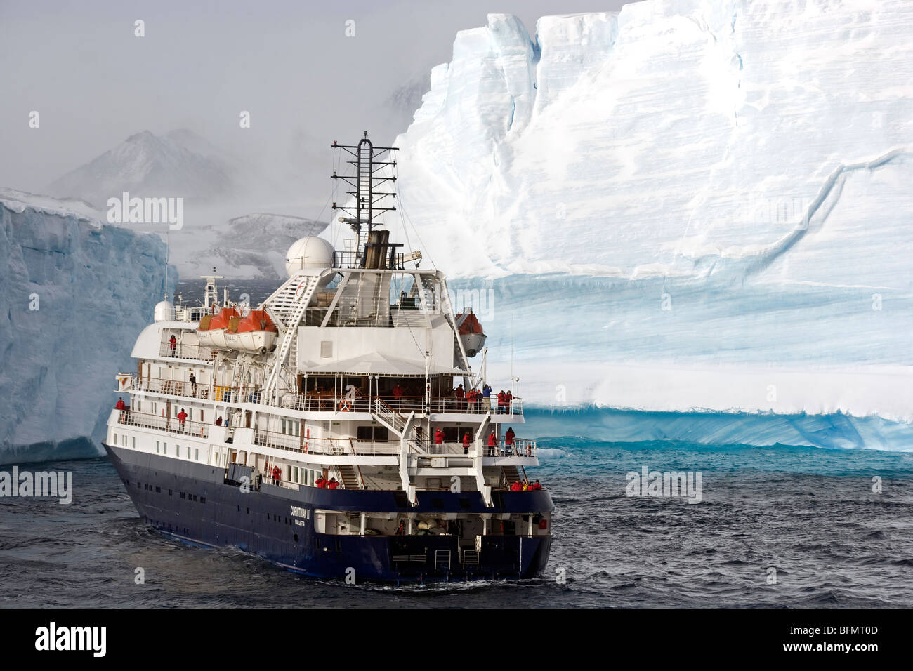 Antarctica, Antarctic Sound and Hope Bay, expedition ship the Corinthian III is dwarfed by the tabular icebergs. - Stock Image