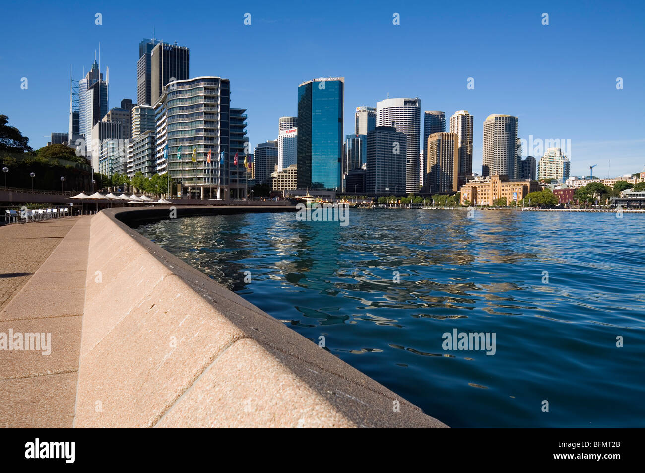 Australia, New South Wales, Sydney.  View along Sydney Cove waterfront towards Circular Quay and the city skyline. - Stock Image