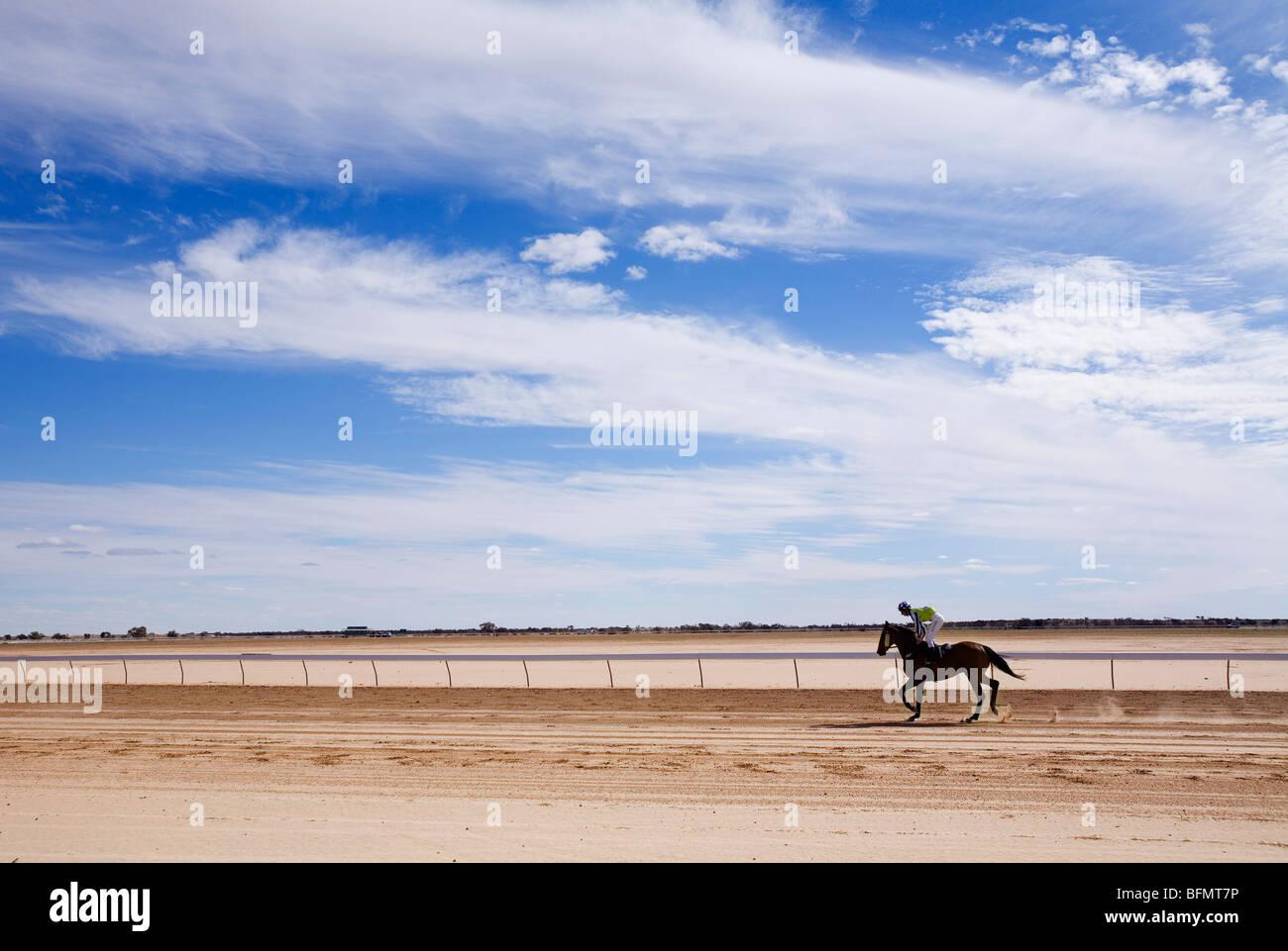 Australia, Queensland, Birdsville.  A horse rider on the dirt track at Birdsville during the annual Birdsville Cup - Stock Image