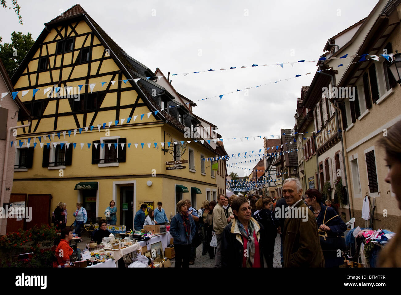 A flea market takes place in the historic heart of Ladenburg, Germany - Stock Image