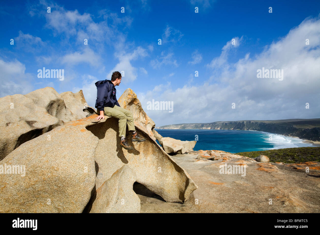 Australia, South Australia, Kangaroo Island.  A tourist atop the Remarkable Rocks in the Flinders Chase National - Stock Image