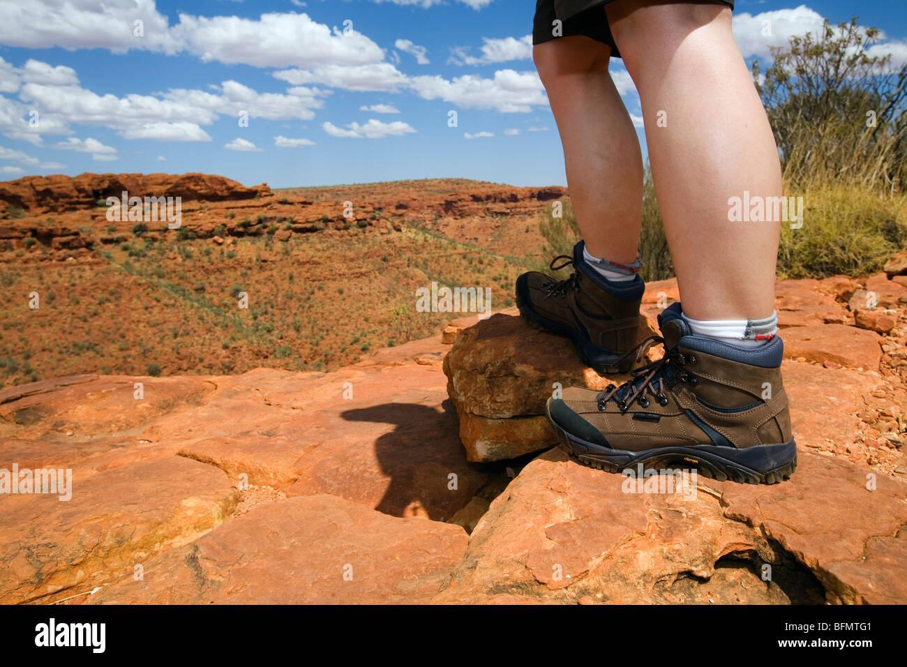 Australia, Northern Territory, Watarrka (Kings Canyon) National Park.  Hiker on the Kings Canyon rim walk. (MR) Stock Photo