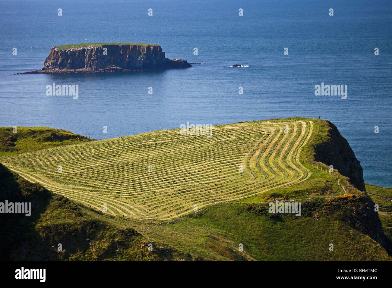 United Kingdom, Northern Ireland, Antrim, Ballycastle, Ballintoy, view of ploughed field. - Stock Image