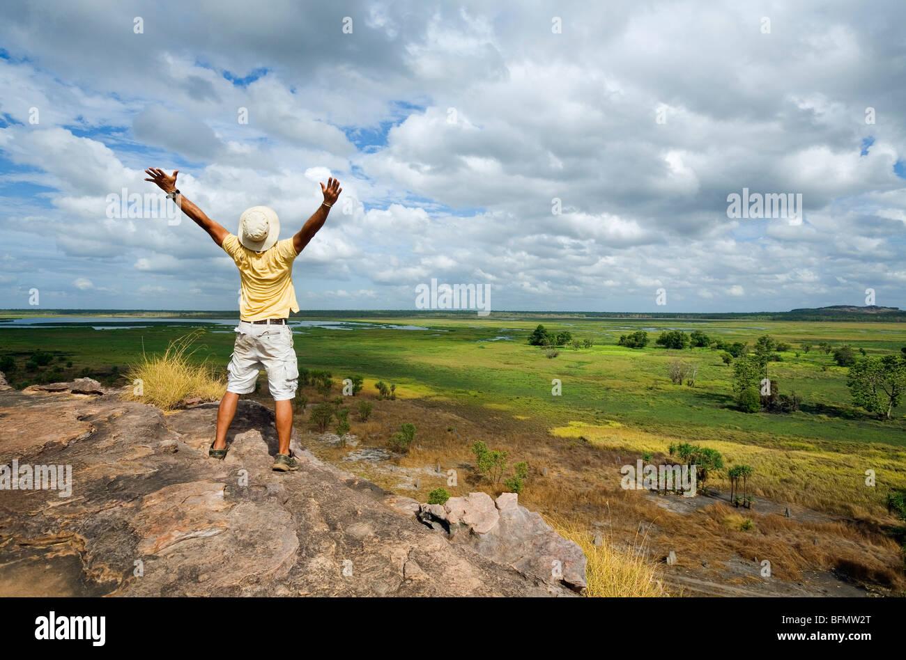 Australia, Northern Territory, Kakadu National Park. A tourist stands atop the Nadab escarpment at Ubirr. (MR) (PR) Stock Photo