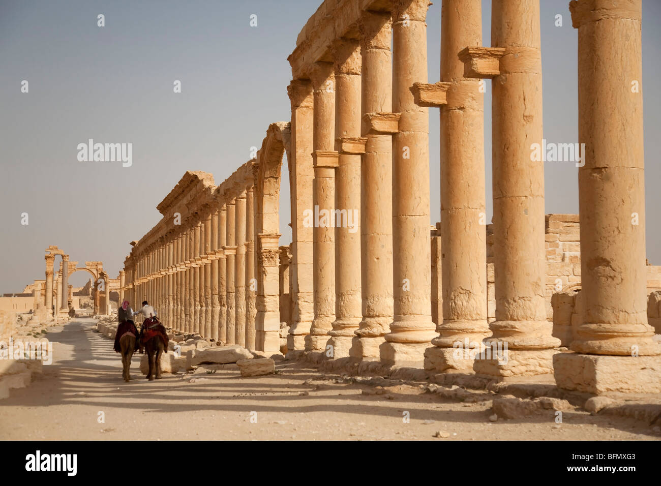 Syria, Palmyra. Riding amongst the ancient ruins of Queen Zenobia's city at Palmyra. - Stock Image