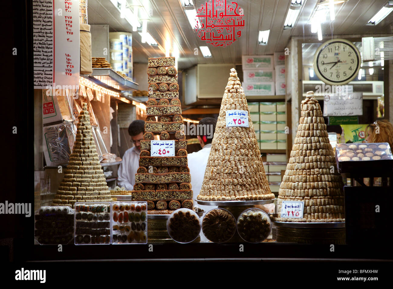 Syria, Damascus. Baclava and other Syrian pastries and treats piled neatly in a patisserie window. Stock Photo