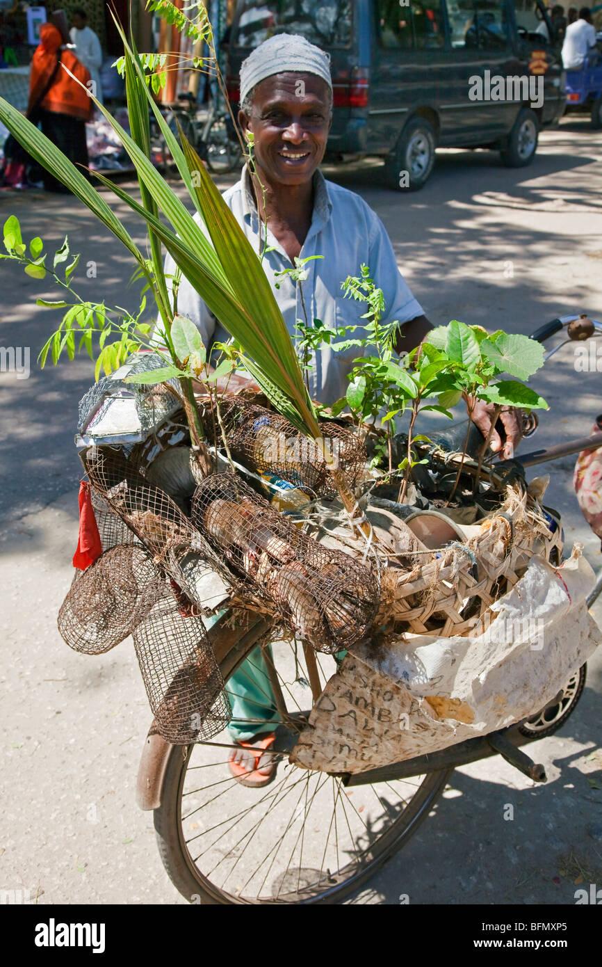 Tanzania, Zanzibar, Stone Town. An enterprising man at Zanzibars Central Market selling homemade rattraps and plants. - Stock Image