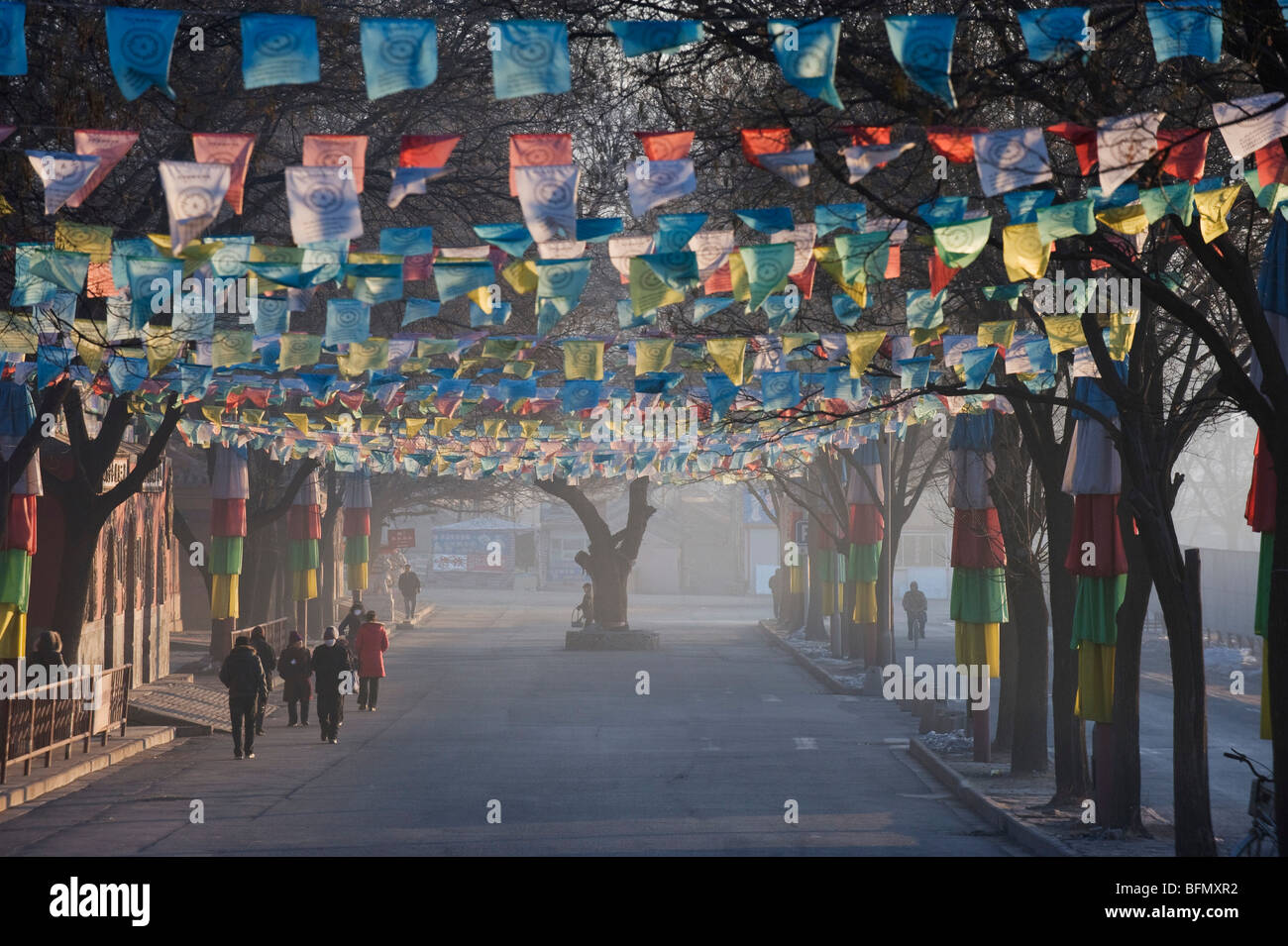 China, Hebei Province, Chengde, Tibetan prayer flags lining a street - Stock Image