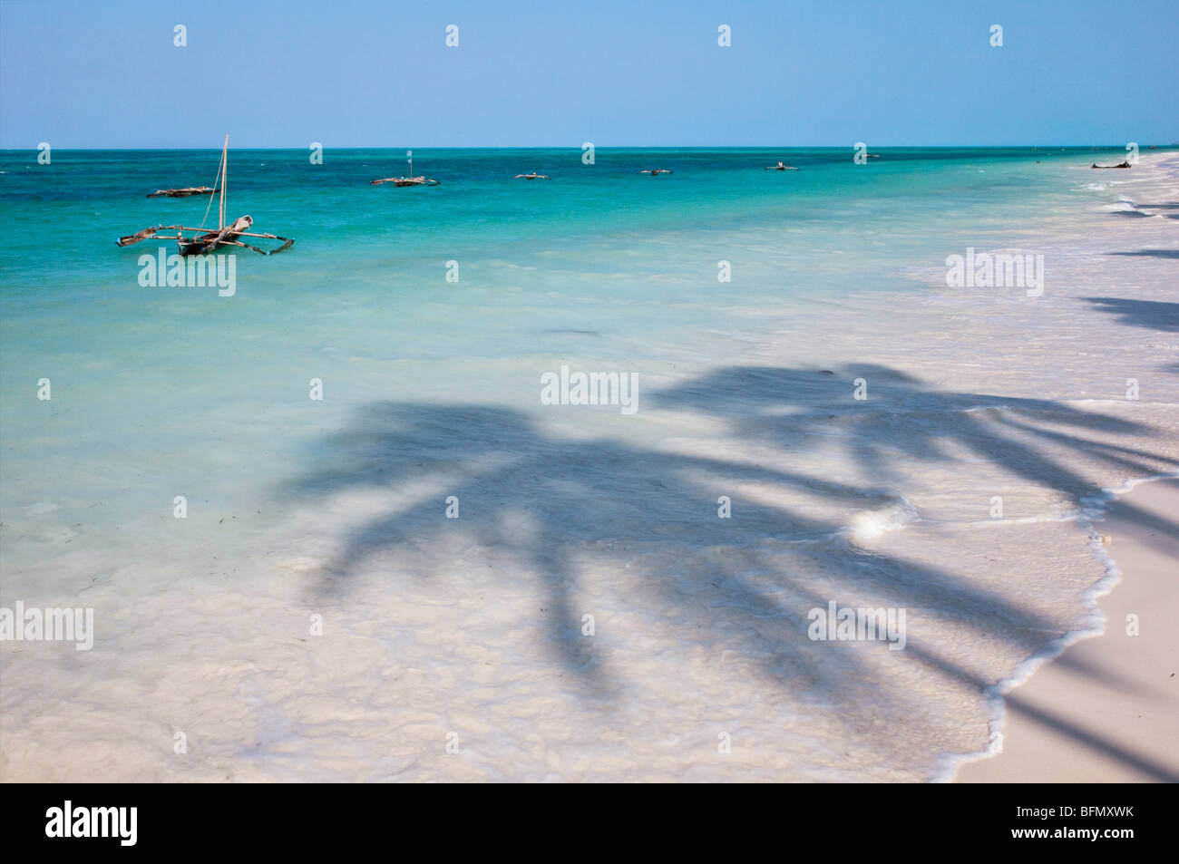 The coconut palm-lined beach at Jambiani has one of the finest beaches in the southeast of Zanzibar Island. - Stock Image