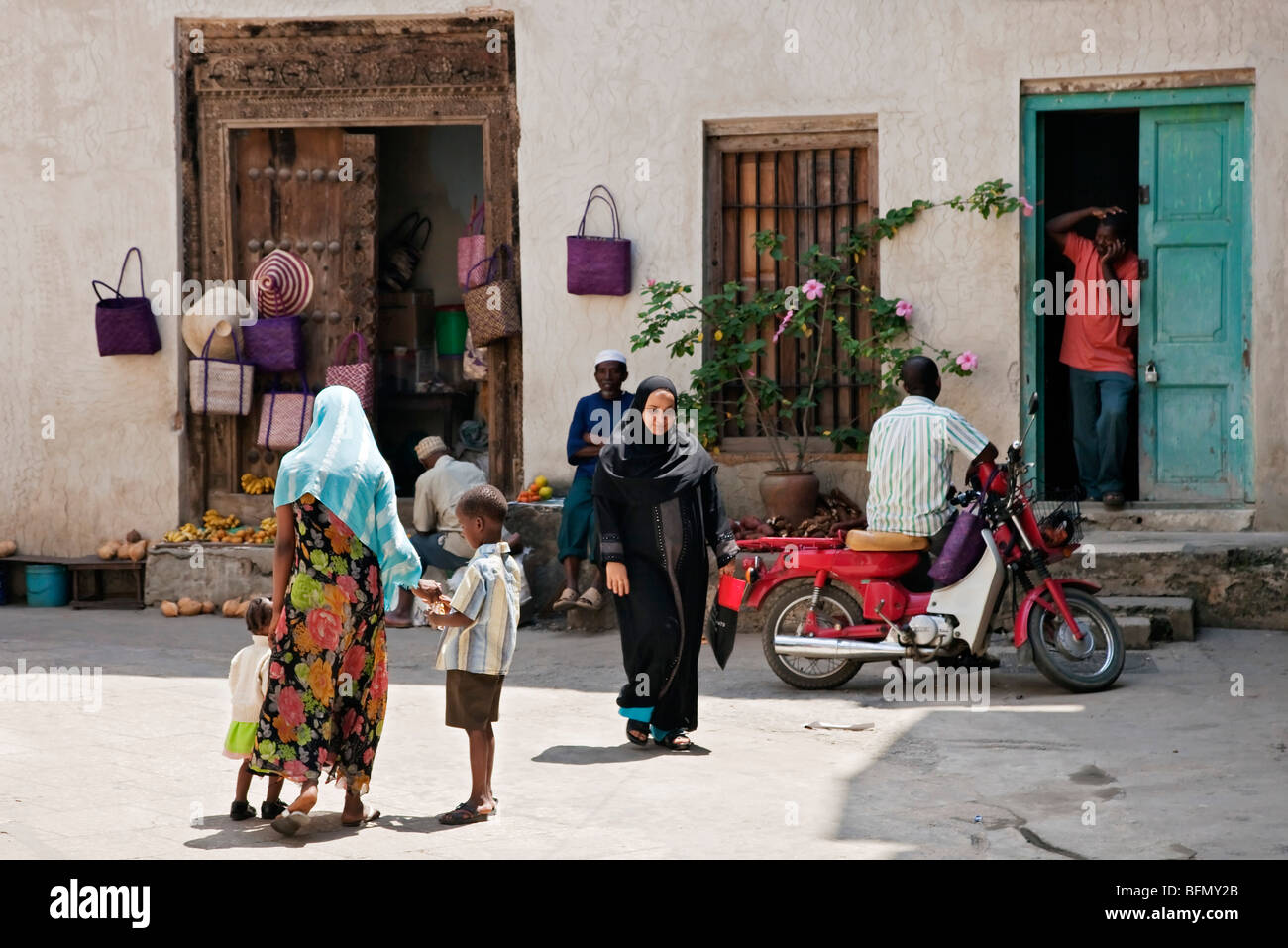 Tanzania, Zanzibar, Stone Town. A typical scene with a small general store in one of Stone Town  s maze of narrow - Stock Image