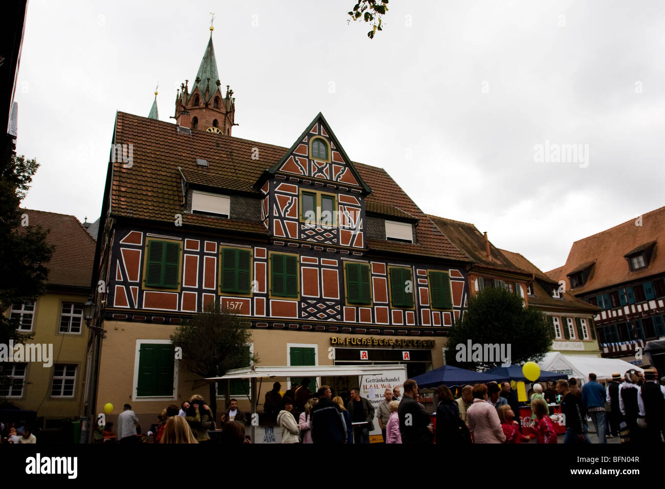 A historical Fachwerkbau building in Ladenburg, Germany during a local festival - Stock Image