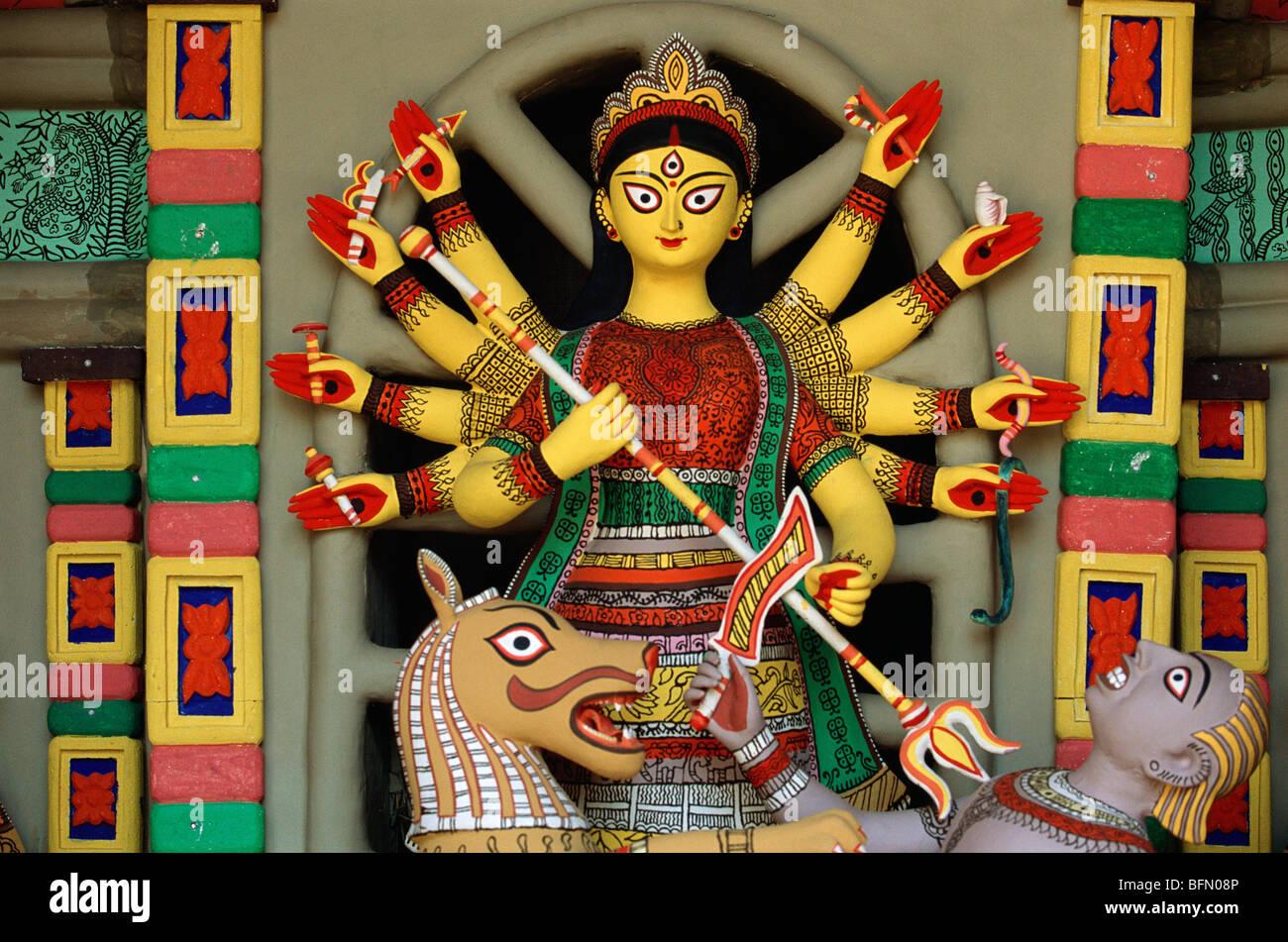 BPM 60883 : Durga Puja ; stylised goddess idol mounted on lion killing demon festival of India - Stock Image