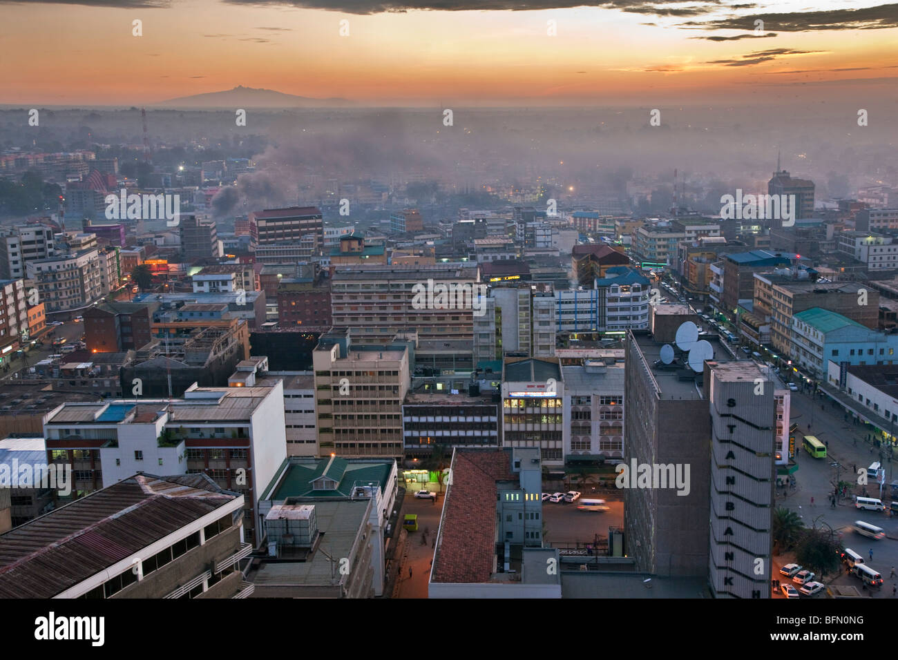 Kenya, Nairobi. Nairobi at daybreak with Mount Kenya rising in the far distance. - Stock Image