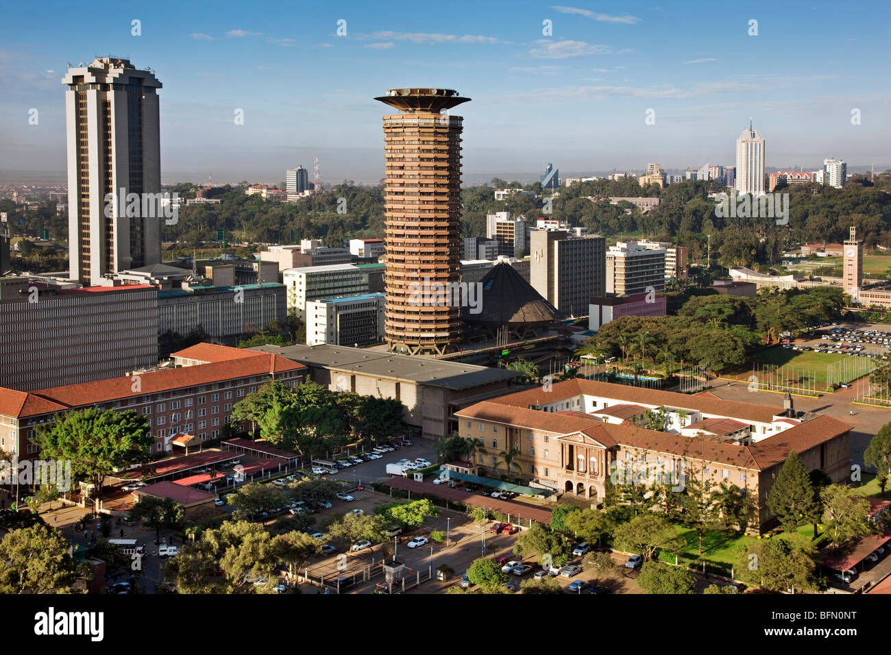 Kenya, Nairobi. Nairobi in early morning sunlight with the circular tower of the Kenyatta Conference Centre in the - Stock Image