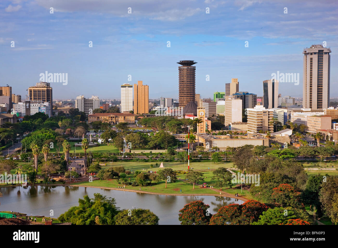Kenya, Nairobi. Nairobi in late afternoon sunlight with Uhuru Park in the foreground. - Stock Image