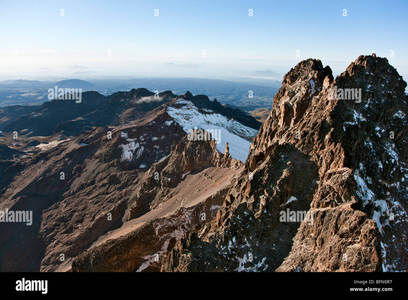 Kenya. The snow-dusted twin peaks of Mount Kenya, Africa  s second highest mountain, with Point Lenana and Lewis - Stock Image