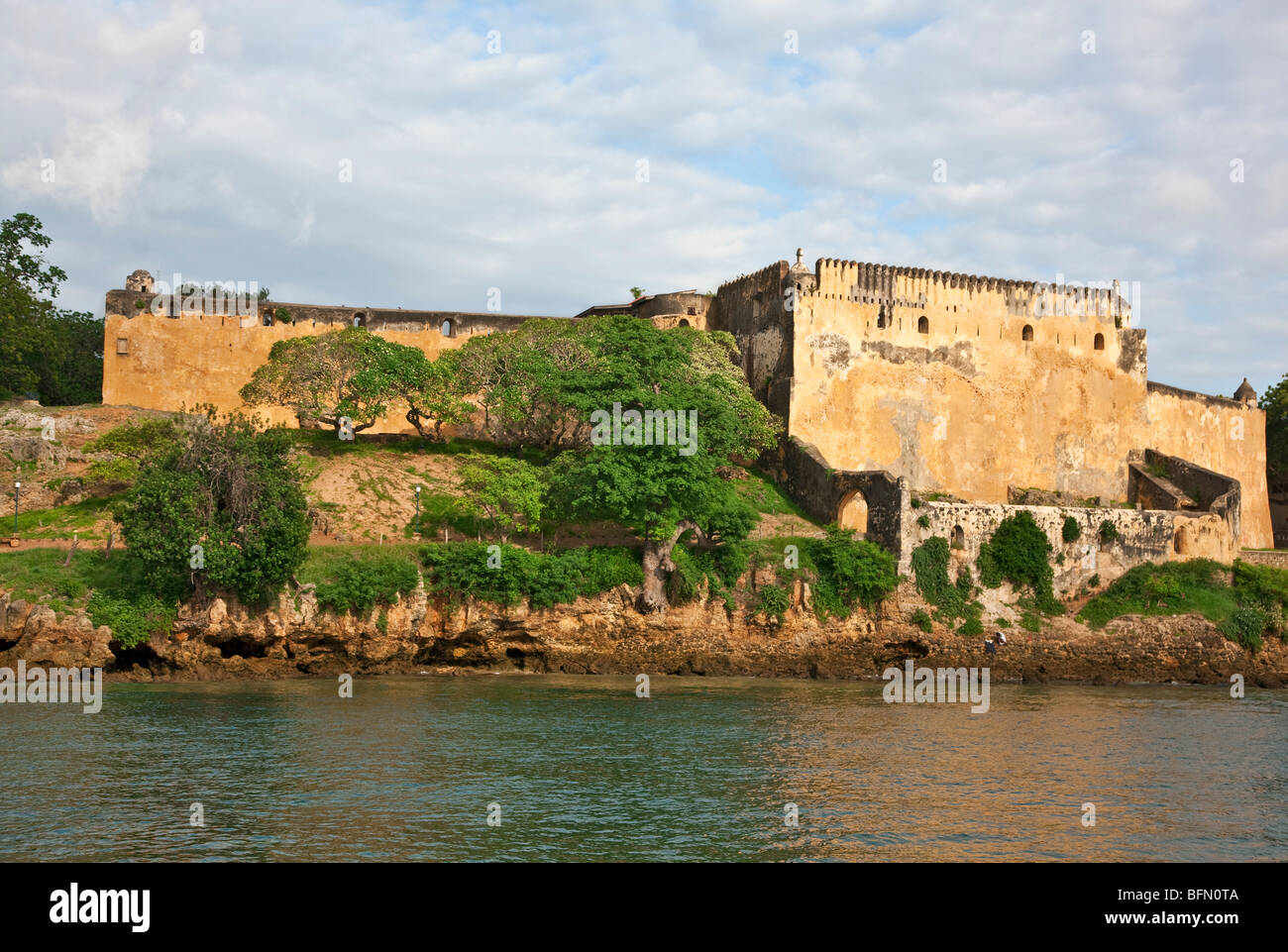 Kenya, Mombasa. Historic Fort Jesus, built by the Portuguese in 1593, is situated at the entrance to the old dhow - Stock Image