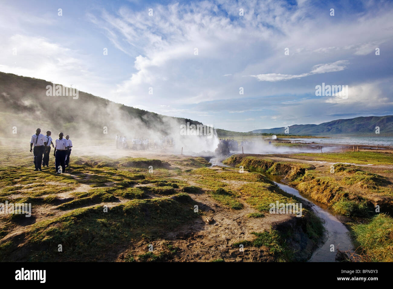Kenya, Bogoria. School children on an official school outing visit the geysers and hot springs beside Lake Bogoria. - Stock Image