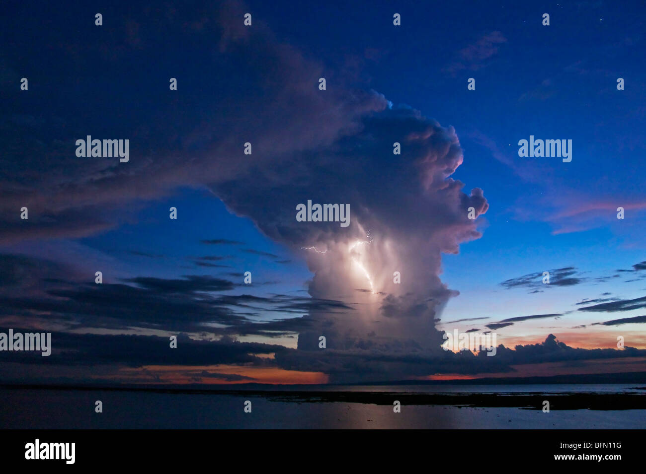 Kenya, Nyanza District. A violent evening storm with forked lightning over Lake Victoria . - Stock Image