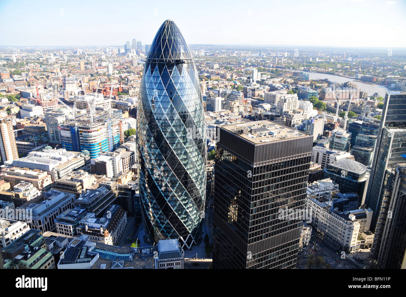 The Swiss Re Building (The Gherkin) at 30 St Mary Axe in The City of London, designed by Sir Norman Foster. - Stock Image