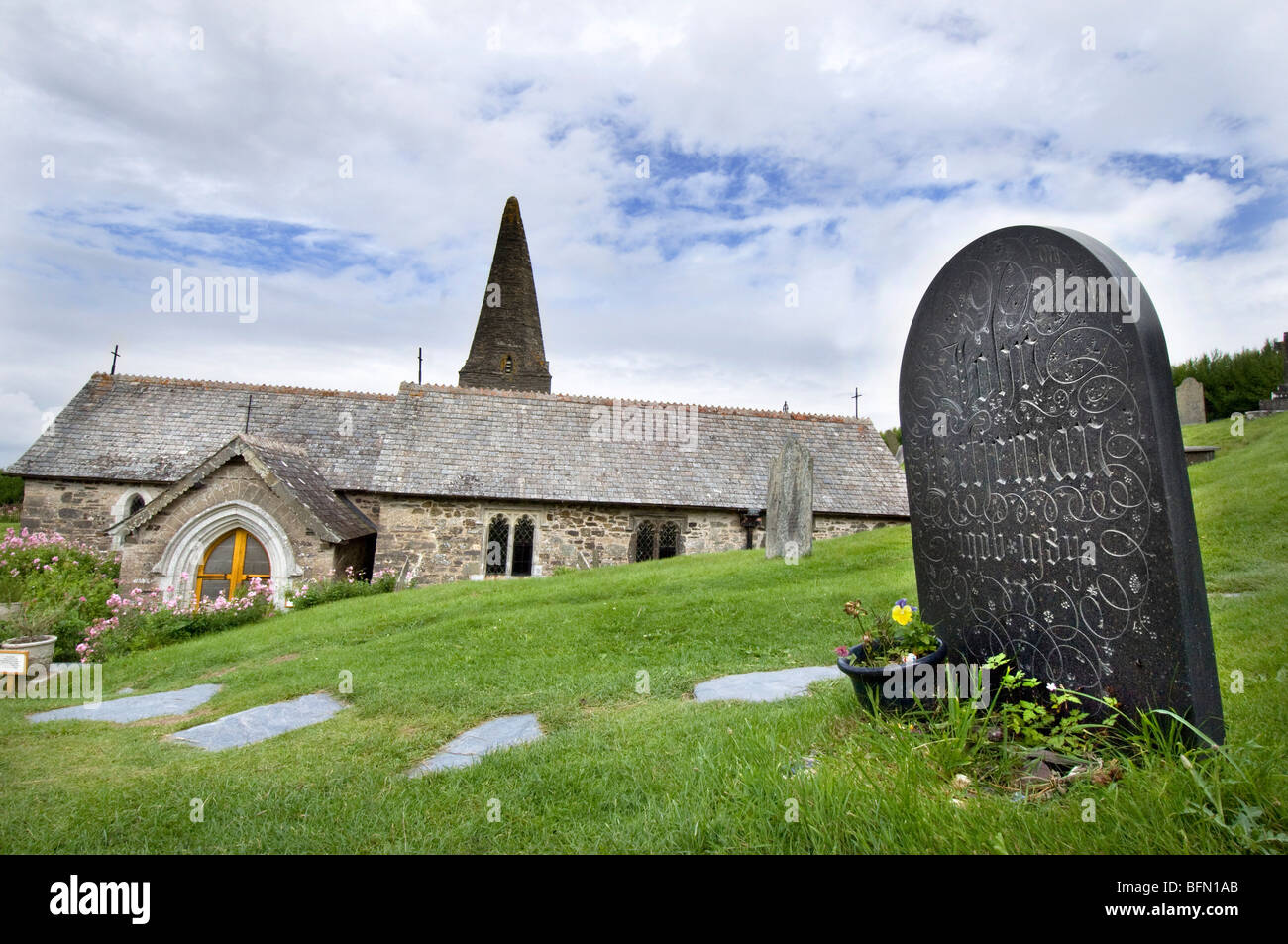 Poet Laureate Sir John Betjeman's grave and headstone carved on Delabole slate at St. Enadoc Church, Cornwall - Stock Image
