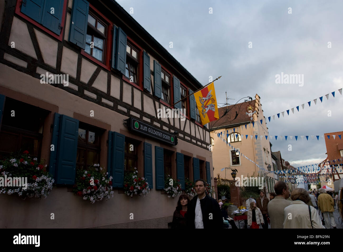 Street scene with historical Fachwerkbau in Ladenburg, Germany - Stock Image