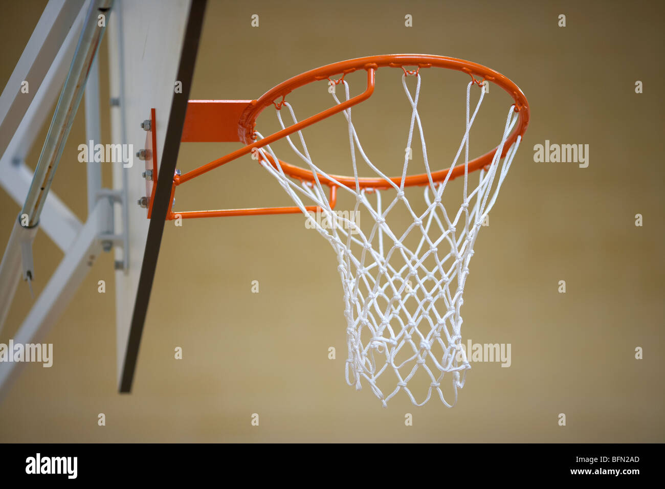 basketball net and frame in a school gym sports hall low angle selective focus Stock Photo