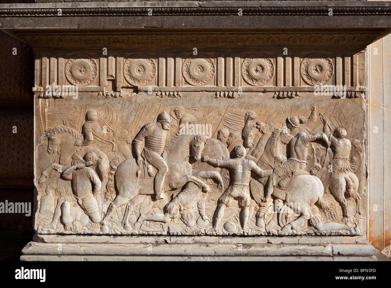 bas relief of battle scene beside west doorway, Palace of Charles V, Alhambra, Granada, Spain - Stock Image