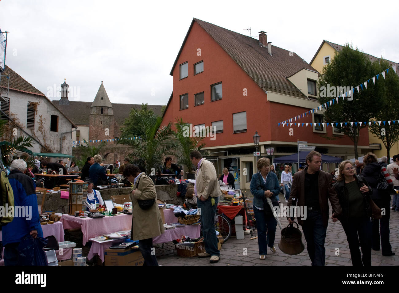 Punters peruse items for sale at a flea market in Ladenburg, Germany - Stock Image