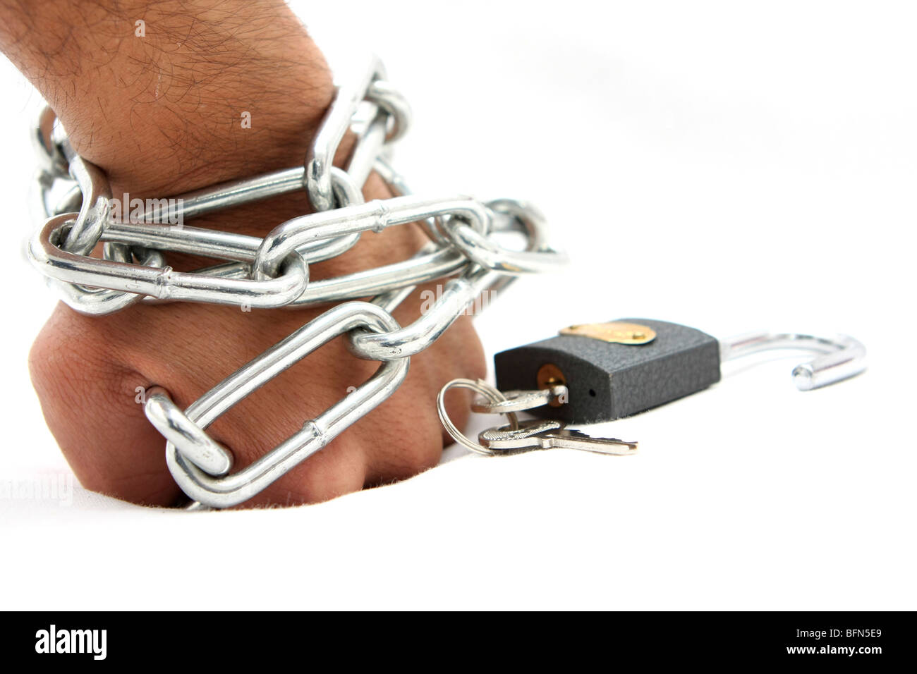 Cutout of a Man's hand chained and locked on white background - Stock Image