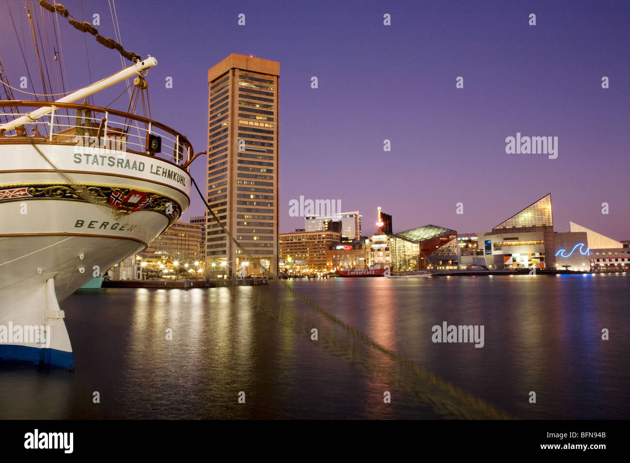 Tall ship visiting Inner Harbor, Baltimore, Maryland including National Aquarium and Pei building - Stock Image