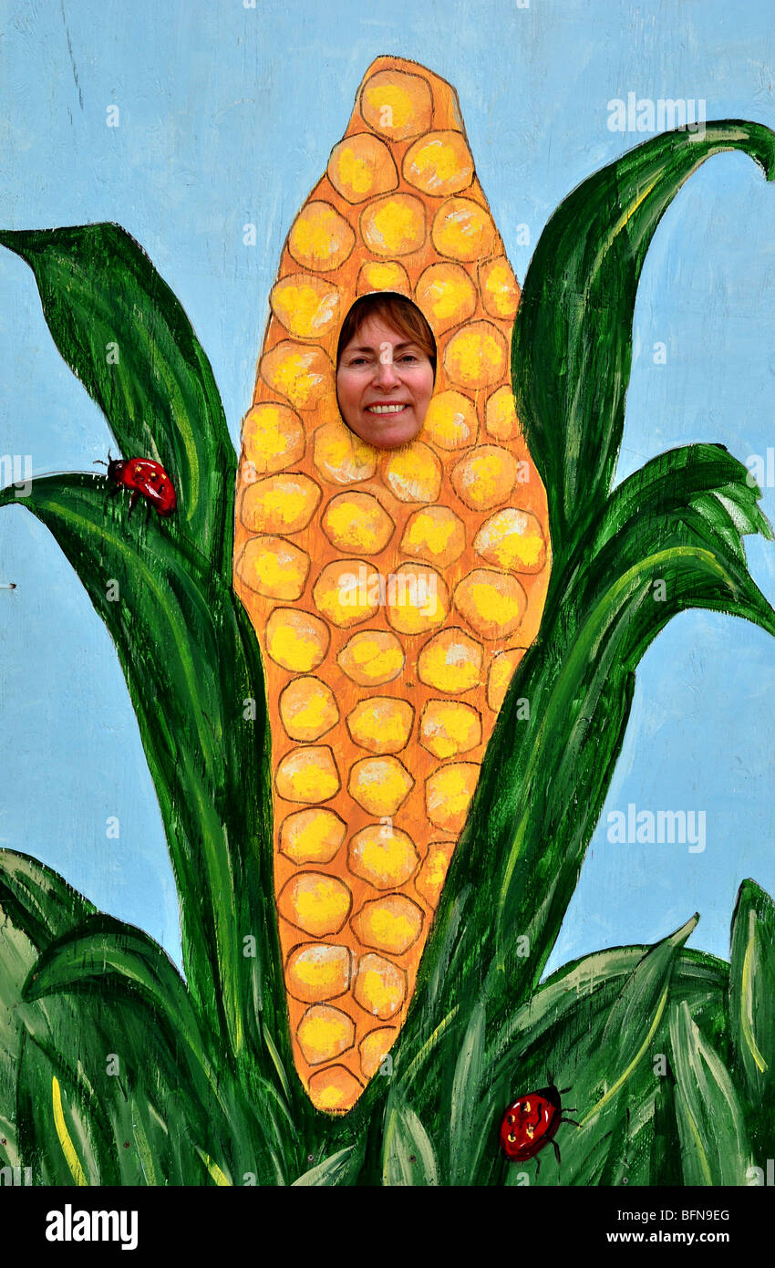 Woman poses in comical photography prop at the Western Idaho Fair in Boise, Idaho - Stock Image
