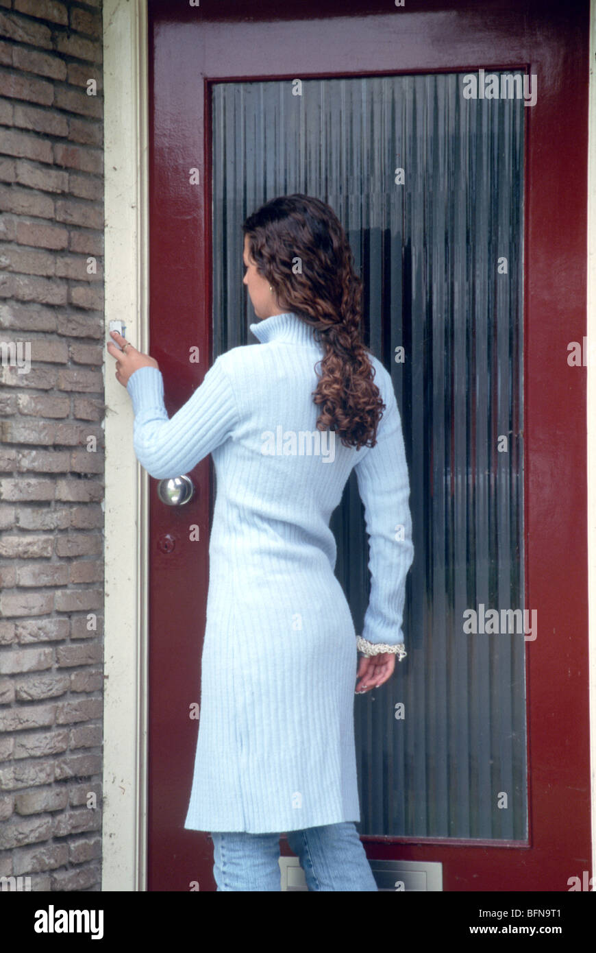 Young Woman Ringing Front Door Bell Stock Photo 26898929 Alamy