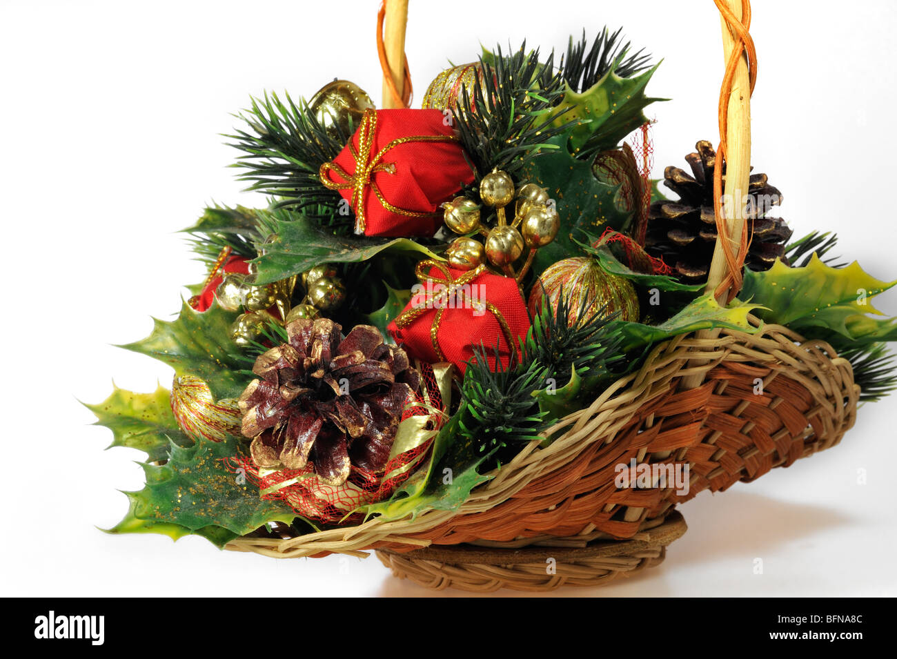 Basket with Christmas ornaments and decorations - Stock Image