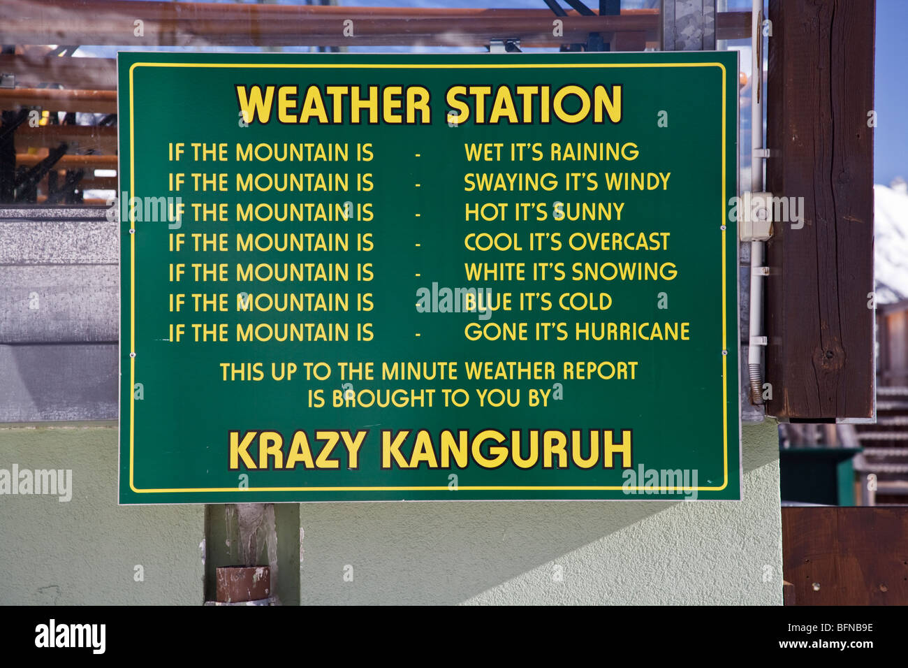 Humerous weather report sign outside the famous Krazy Kanguruh bar - Stock Image
