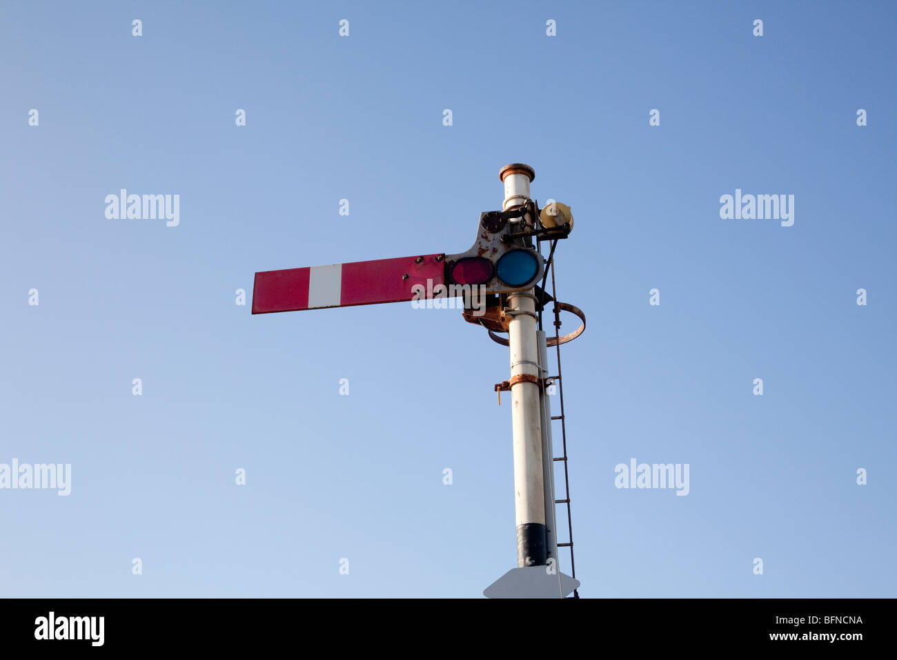 Railway semaphore stop signal in the on position in North Wales station Stock Photo