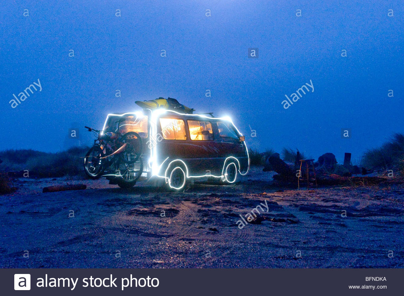 Light painting of a camper van on a beach o the West Coast New Zealand - Stock Image