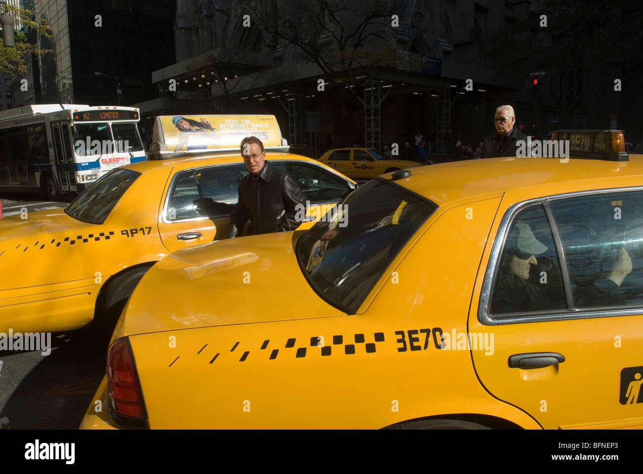 Pedestrians maneuver through gridlocked traffic on Fifth Avenue in New York on Saturday, November 7, 2009. (© - Stock Image