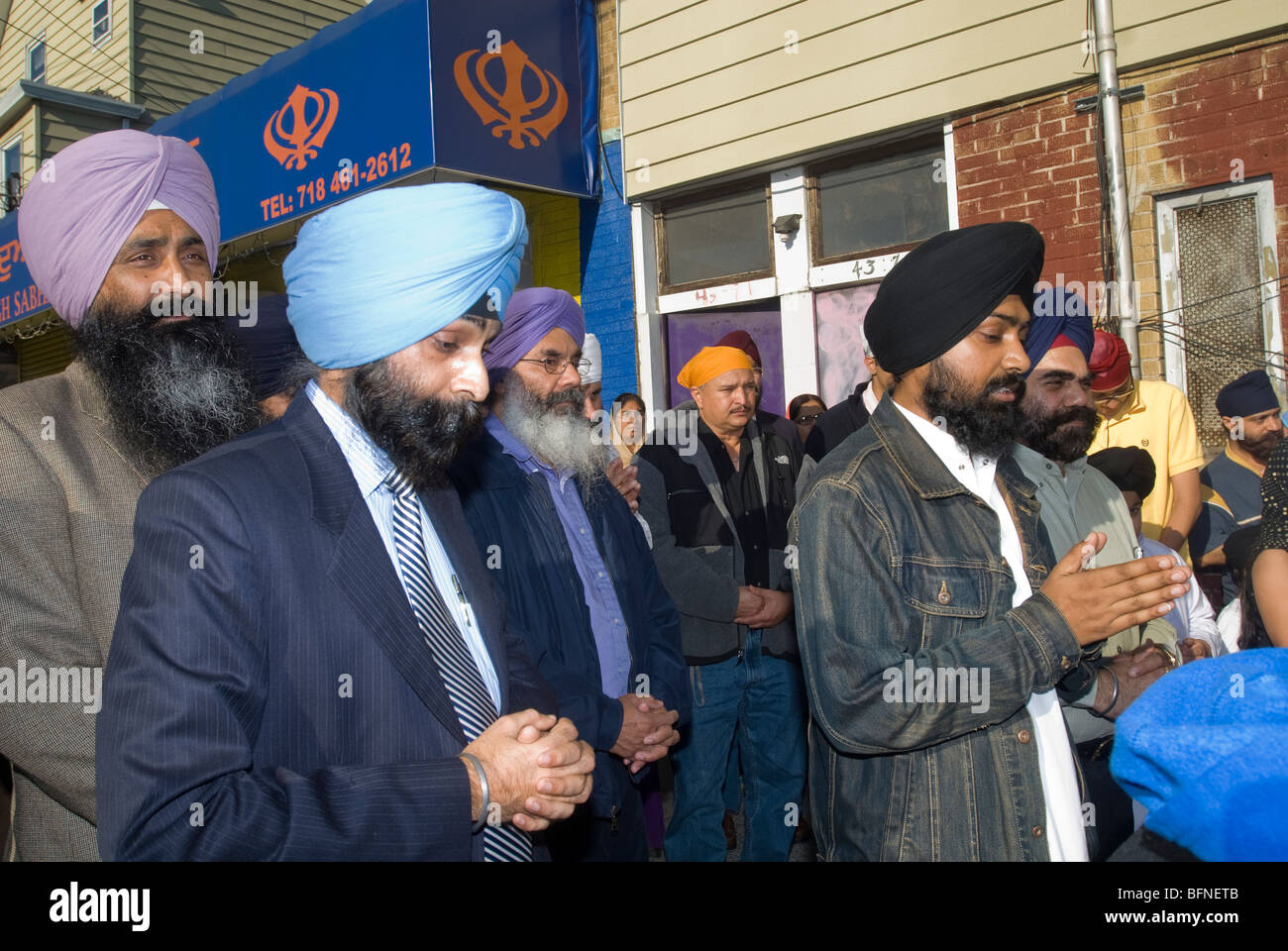 Members the Singh Sabha of New York conduct a prayer with members of other religious congregations in Flushing, - Stock Image