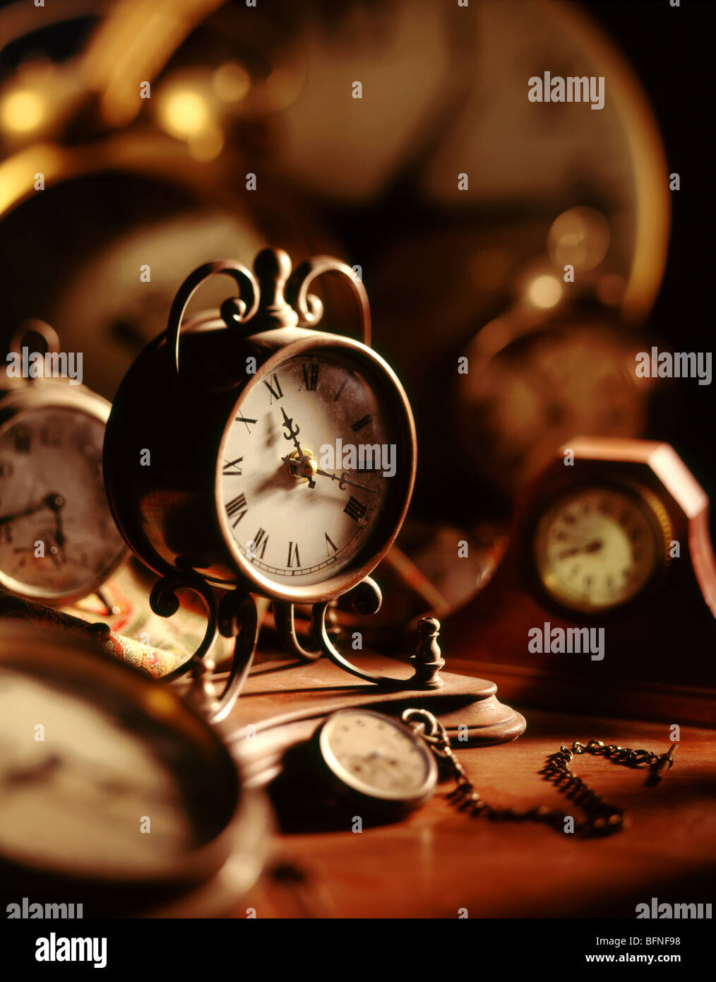 Old clocks and watches on desk - Stock Image