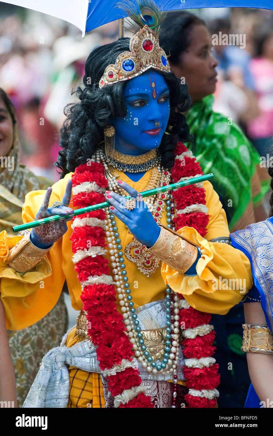 A girl dressed as Lord Krishna attends the celebrations of Ratha Yatra  The Hindu festival of chariots in London - Stock Image