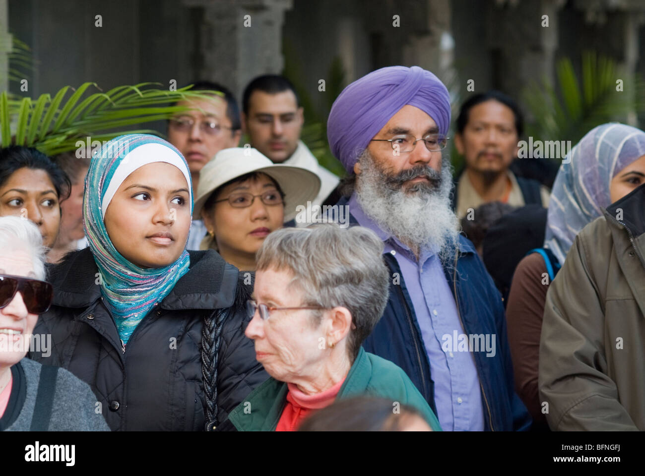 Members of religious congregations in Flushing, Queens stop at the Hindu Temple Center during the Queens Interfaith - Stock Image