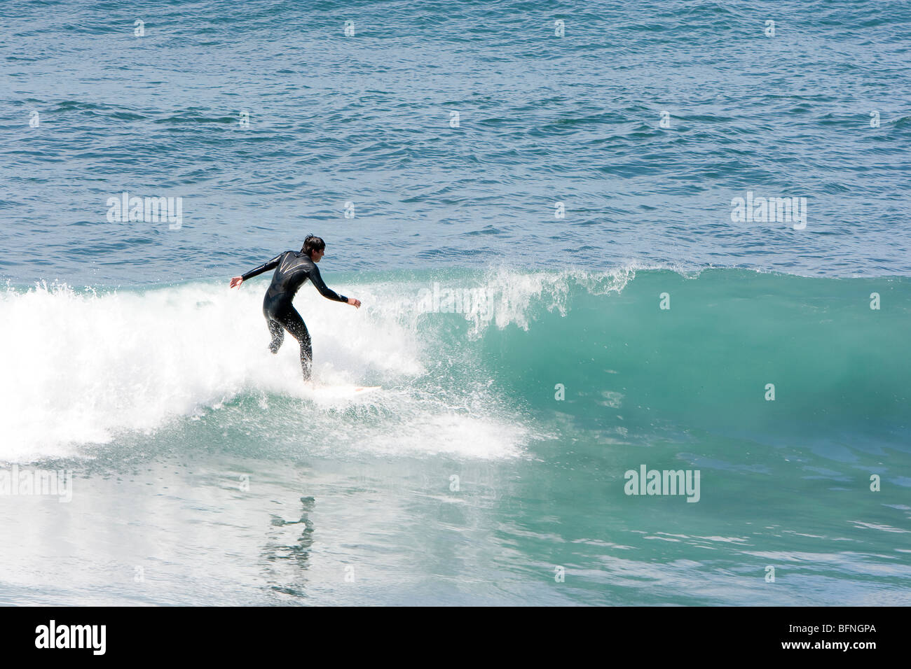 image of people practicing surf in the beach - Stock Image