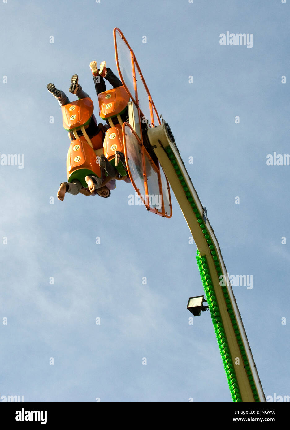 Four people spinning  in the air on a thrill ride - Stock Image