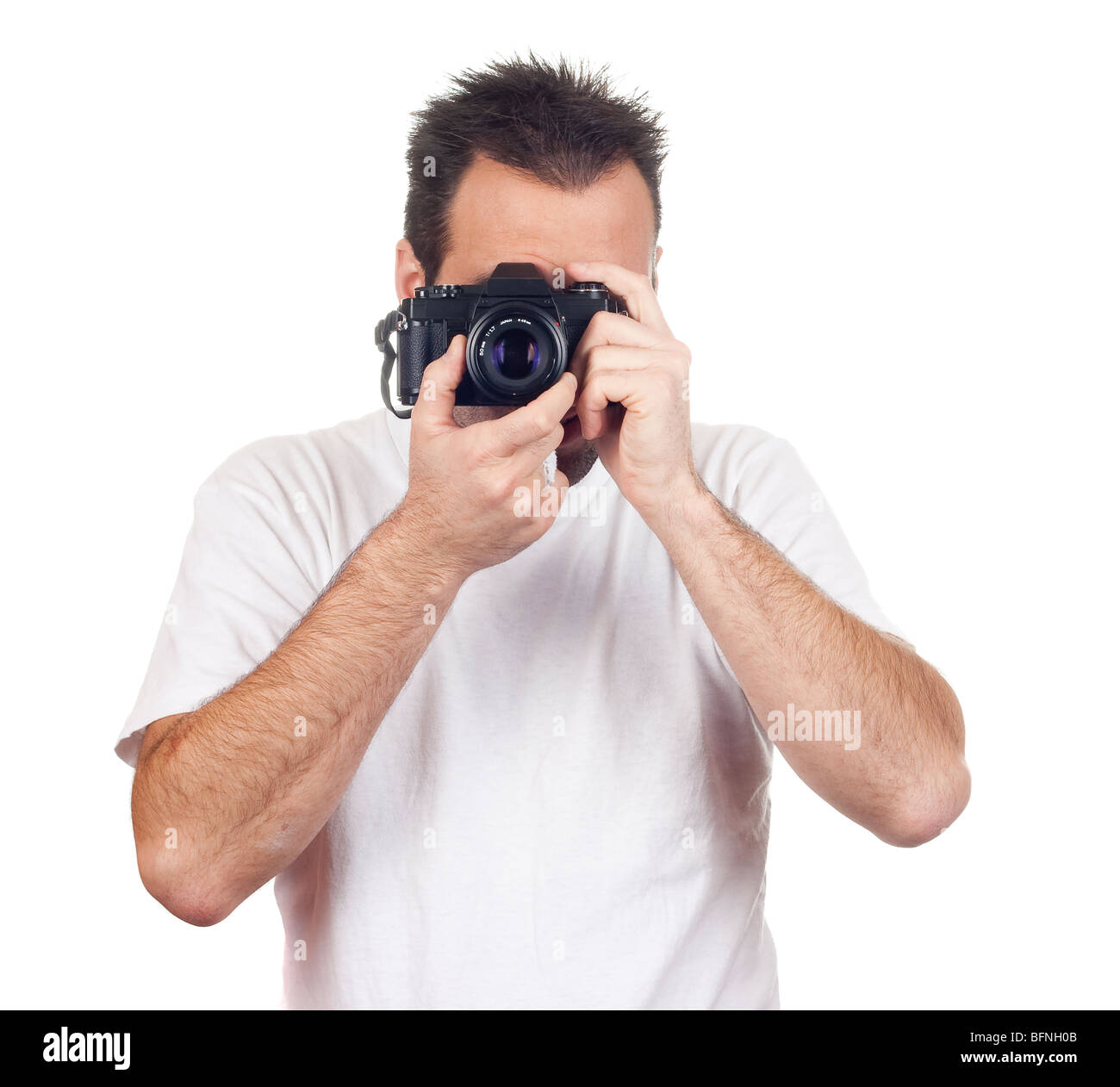 a photographer with a vintage analogic photographic camera isolated on withe background - Stock Image
