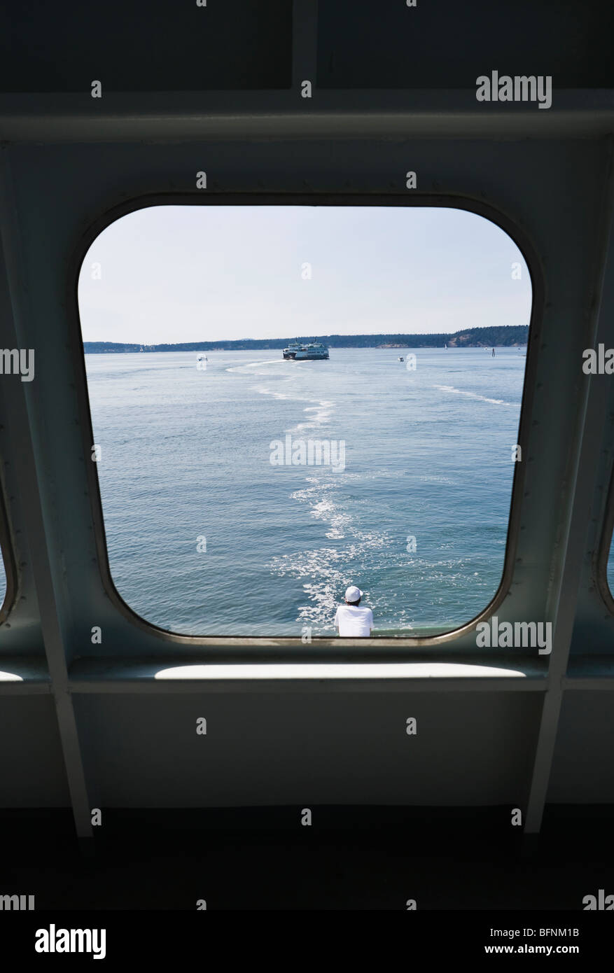 Looking out a window on a Washington State ferry in the San Juan Islands, Washington, USA. - Stock Image