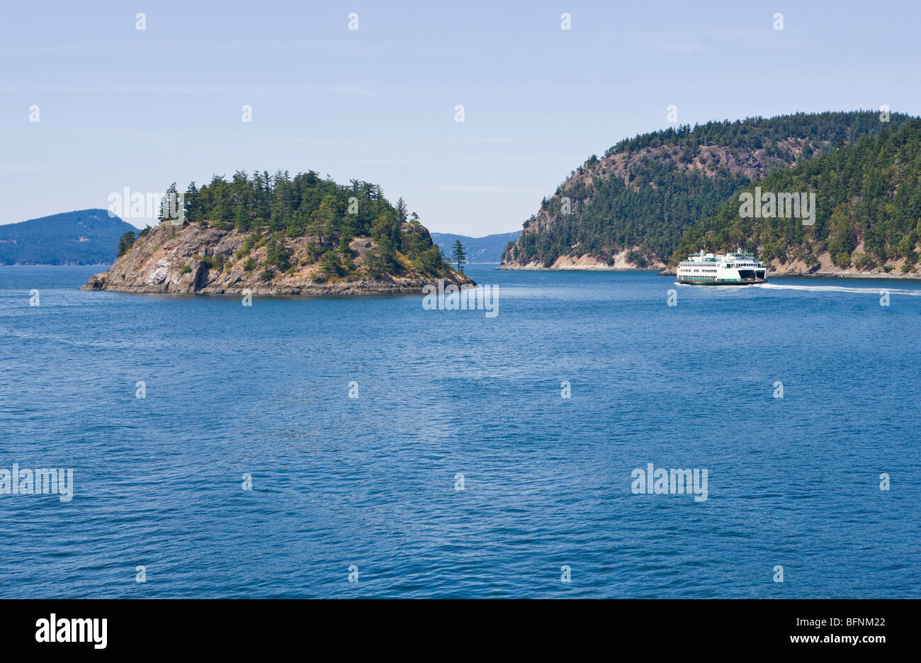 A washington State ferry cruises between two islands in the San Juan Islands of Washington State, USA. - Stock Image